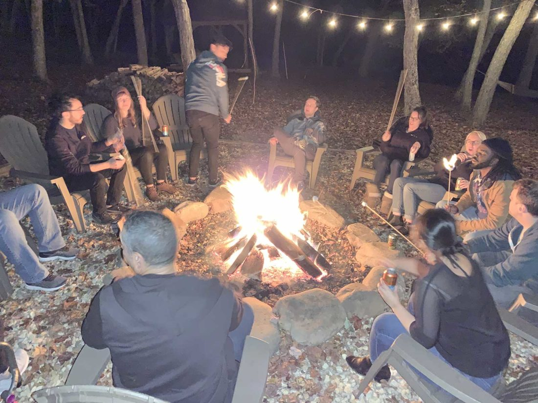The DVI Group team gathered around the campfire at Retreat